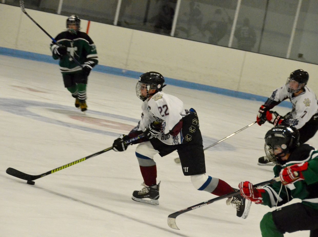 Carter Behrman makes a go on the goal during Craig Youth Hockey Association's 14U Bantam game against Telluride.