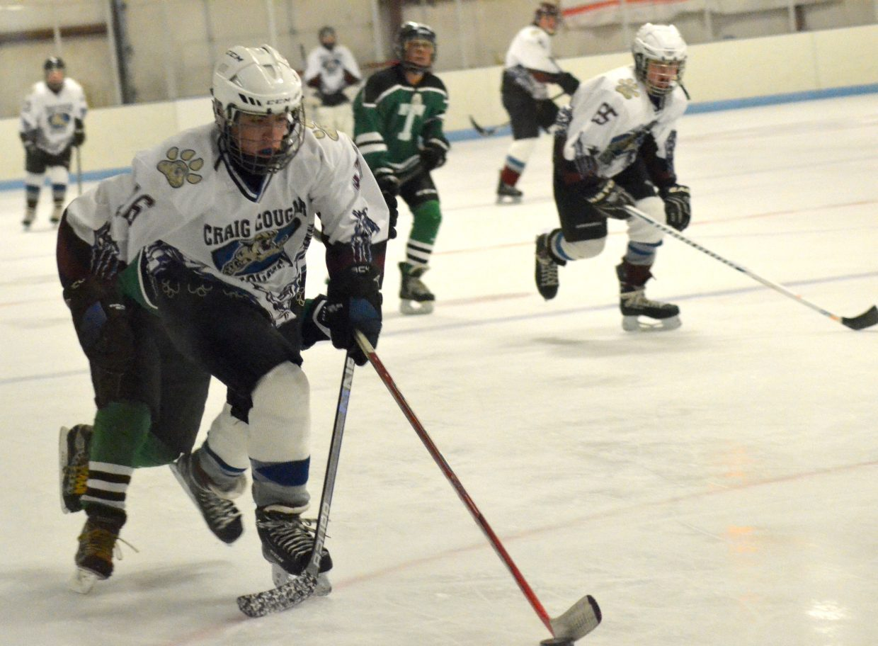 Brant Gutierrez slips past the defense  during Craig Youth Hockey Association's 14U Bantam game against Telluride.