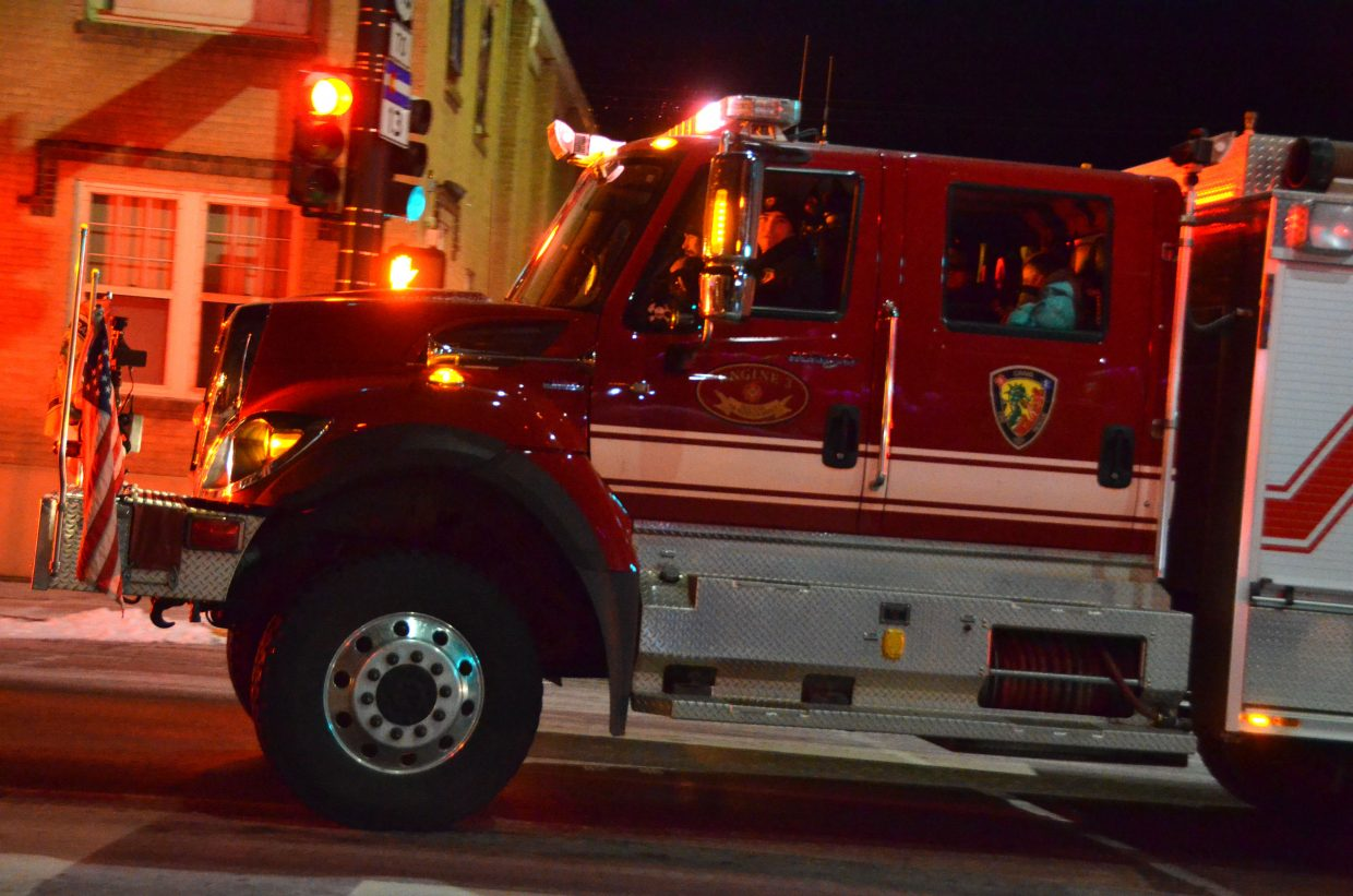 A Craig Fire/Rescue truck is among the first vehicles as part of downtown Craig's Parade of Lights Saturday night.