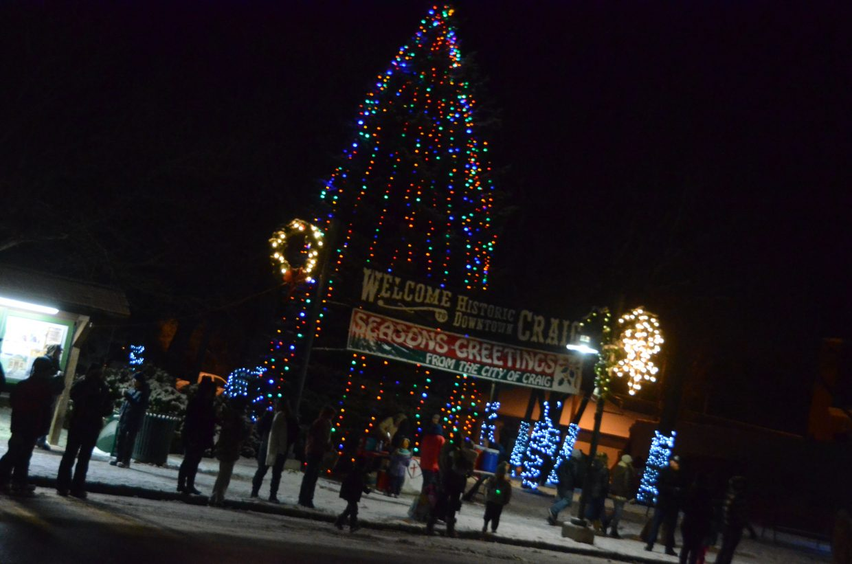 The newly lit tree in Alice Pleasant Park shines brightly leading up to the downtown Craig Parade of Lights Saturday night.