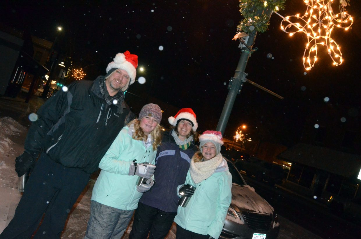 The Jones family, Don, Ellina, Misty and Alexis don their holiday gear and hot beverages to watch the downtown Craig Parade of Lights Saturday night.