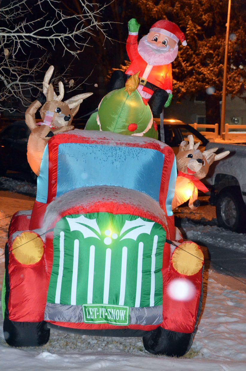 Santa and reindeer sport new wheels outside Lube Plus during downtown Craig's Parade of Lights Saturday night.