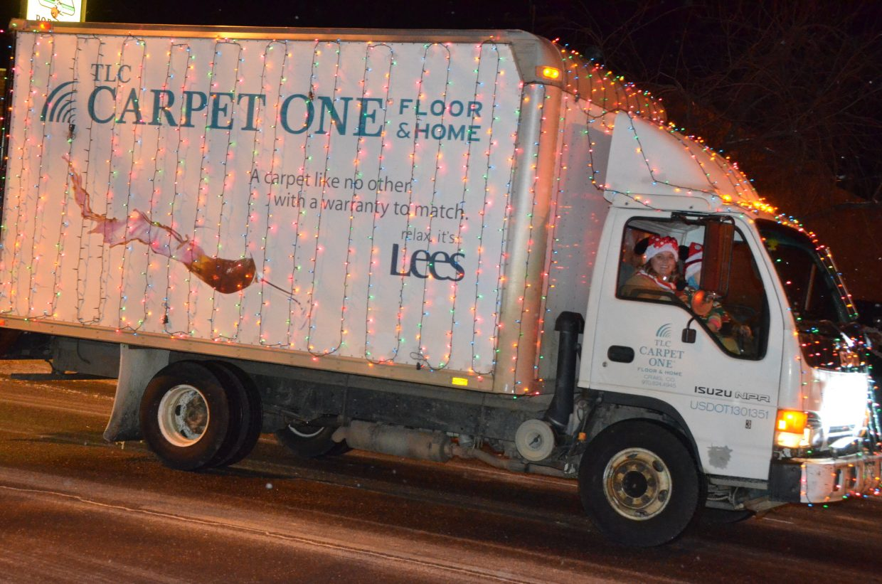 A TLC Carpet One truck is covered top to bottom with decorations during downtown Craig's Parade of Lights Saturday night.