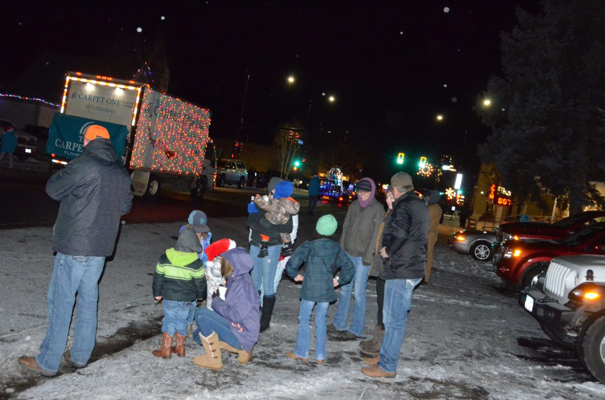 Spectators stake out spots along Yampa Avenue as to enjoy downtown Craig's Parade of Lights Saturday night.
