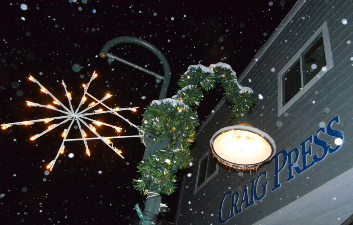 A snowflake and garland outside the Craig Press office Saturday evening.