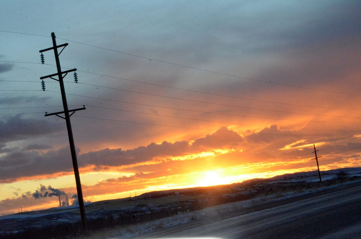 The sun sets on a snowy Moffat County Saturday afternoon.