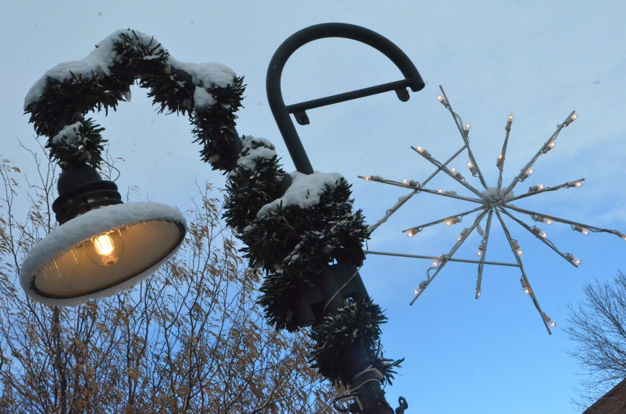 A snowflake and garland outside the Craig Press office Saturday afternoon.