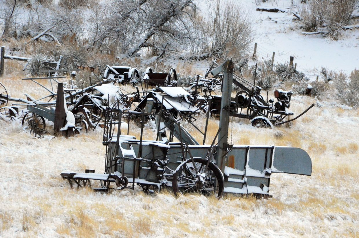Antique farm equipment along US Highway 40 has a new layer of frost Saturday afternoon.