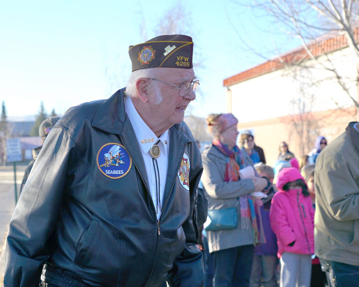 Leon Meats, part of the VFW Color Guard, escorts the flag as part of a flag raising ceremony at Sunset Elementary School on Monday.
