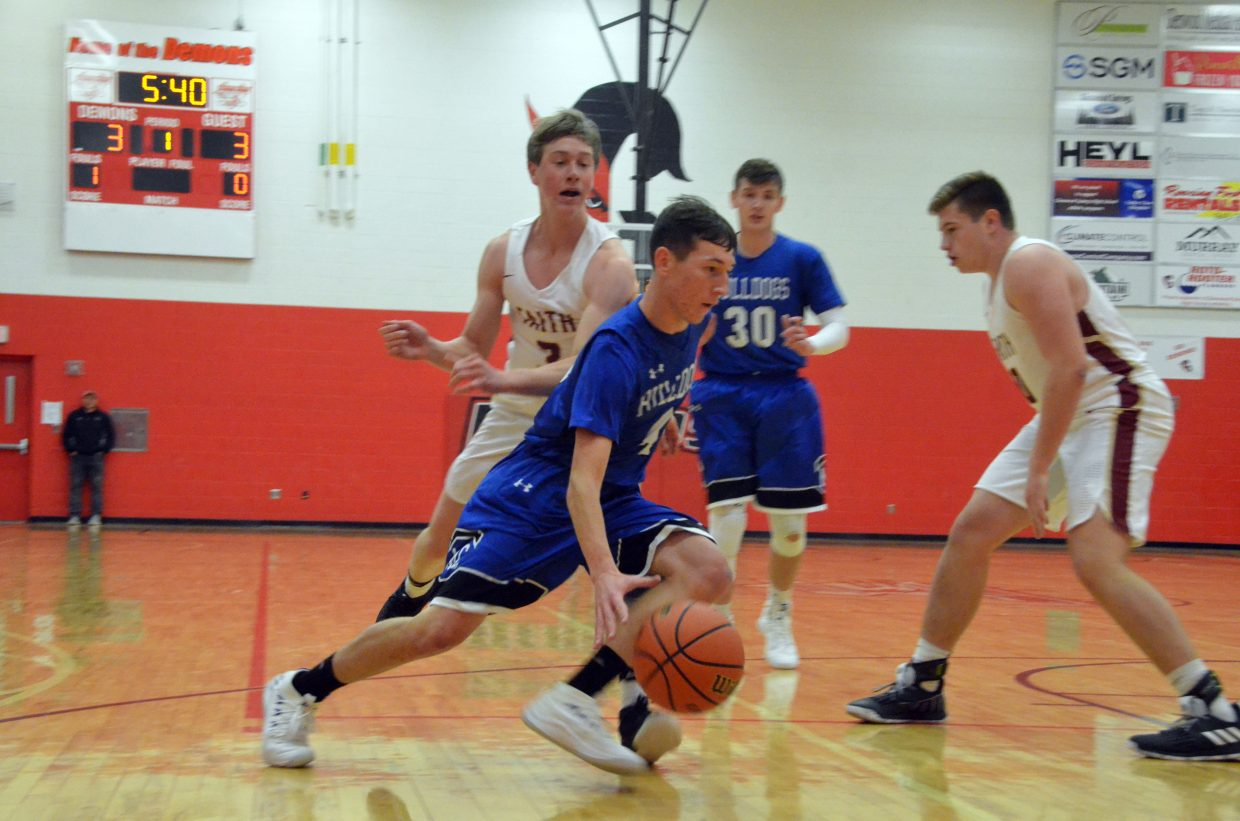 Moffat County High School's Connor Etzler drives to the hoop against Faith Christian.