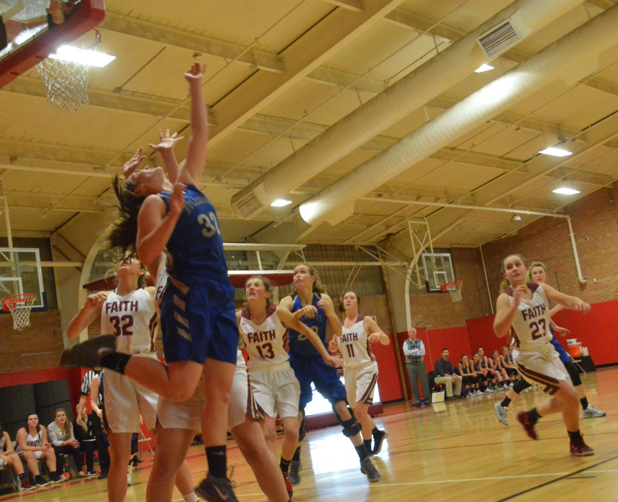 Moffat County High School's Tiffany Hildebrandt angles a shot over her shoulder against Faith Christian.