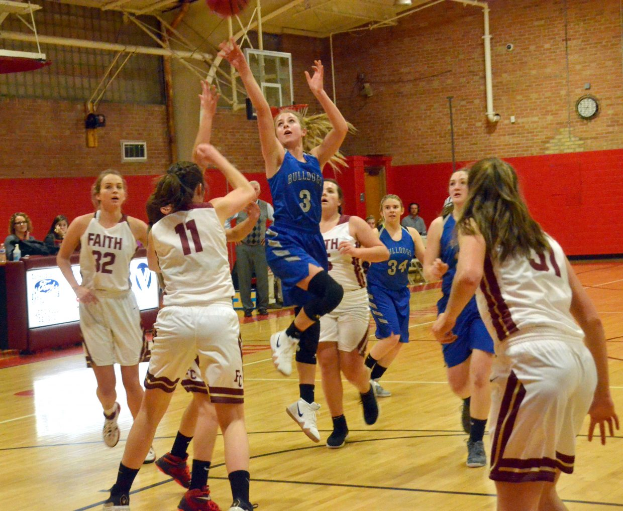 Moffat County High School's Halle Hamilton puts up a jumper against Faith Christian.