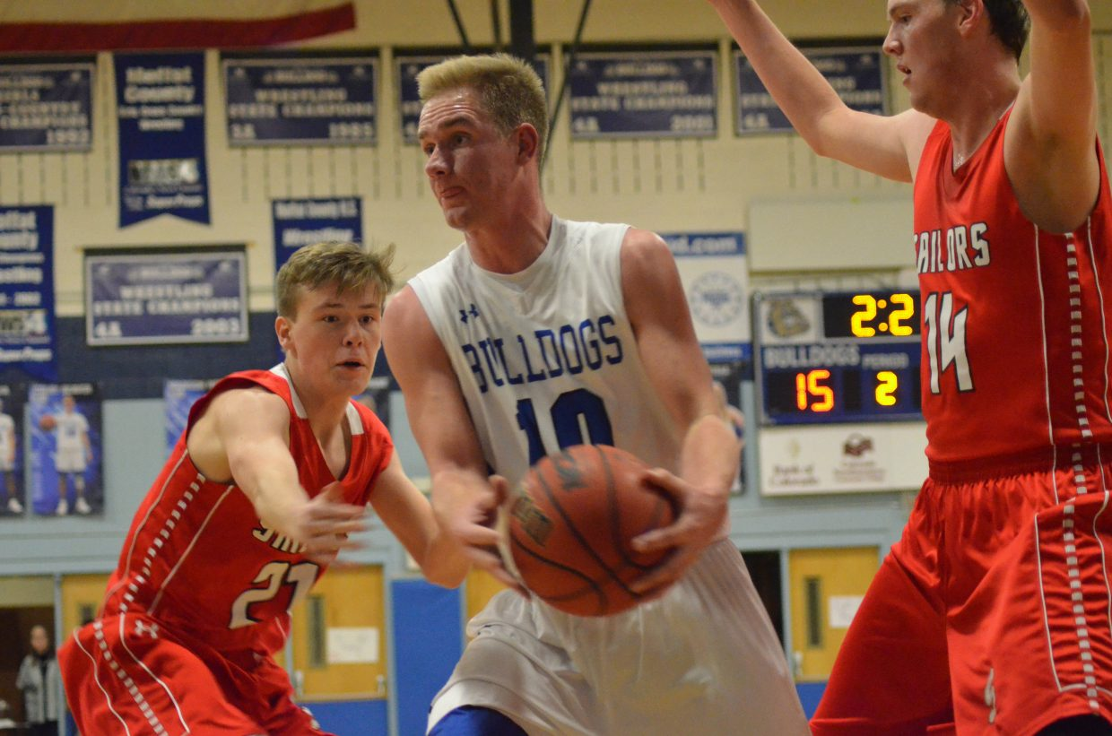 Moffat County High School's Colby Beaver looks to get out of containment by Steamboat Springs opponents during Wednesday's game against the Sailors.