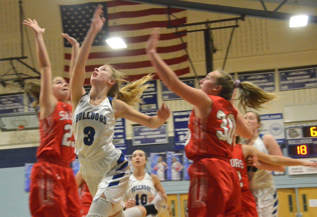Moffat County High School's Halle Hamilton tosses up a shot against Steamboat Springs.