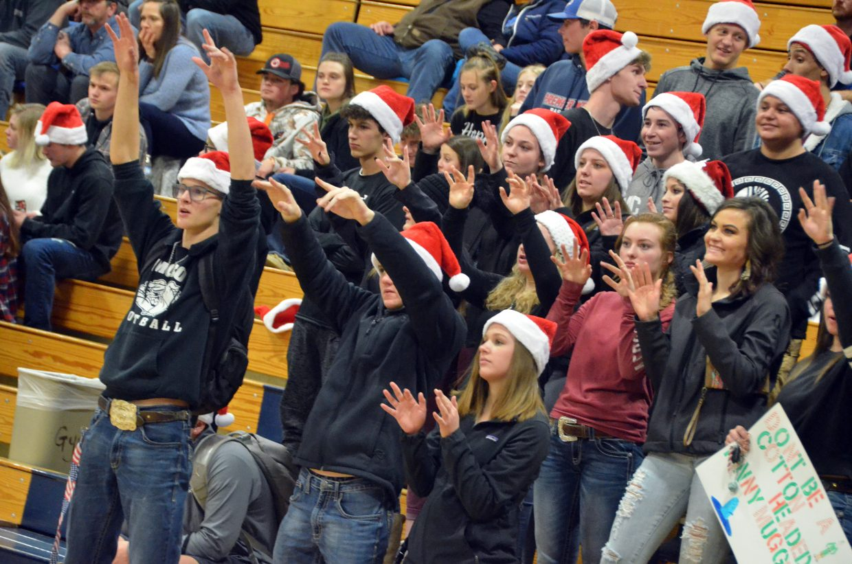 Moffat County High School's student section cheer on the girls basketball team against Steamboat Springs.