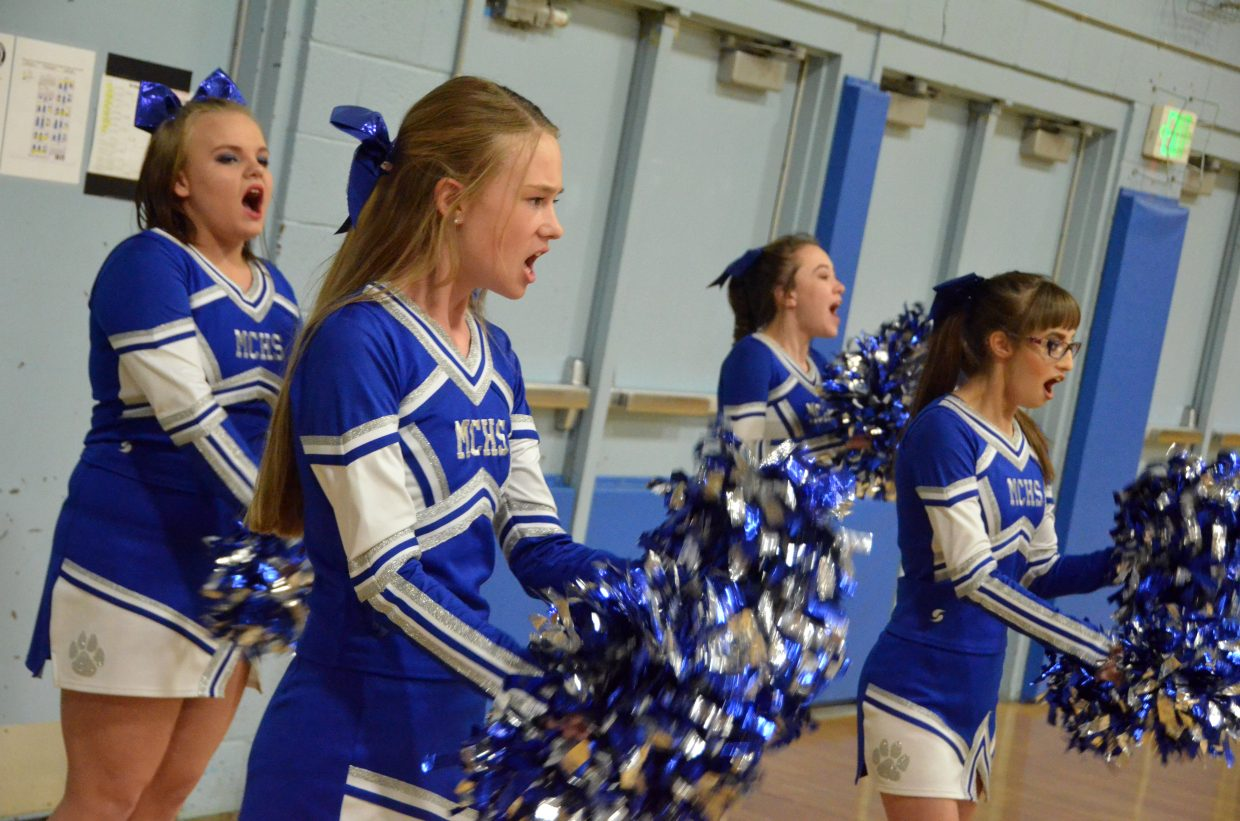 Moffat County High School's cheer team keeps the pep alive in a timeout during Wednesday's basketball game against Steamboat Springs.