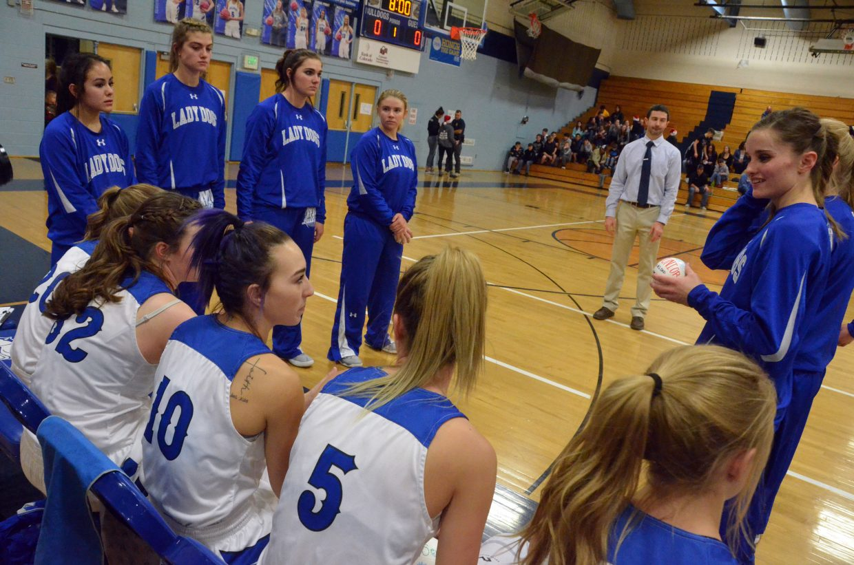 The Moffat County High School varsity girls basketball readies for introductions in Wednesday's games against Steamboat Springs.