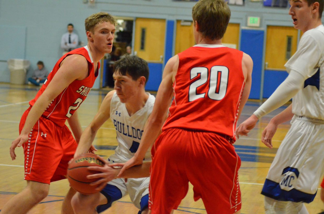 Moffat County High School's Connor Etzler weaves his way around Steamboat Springs defenders.