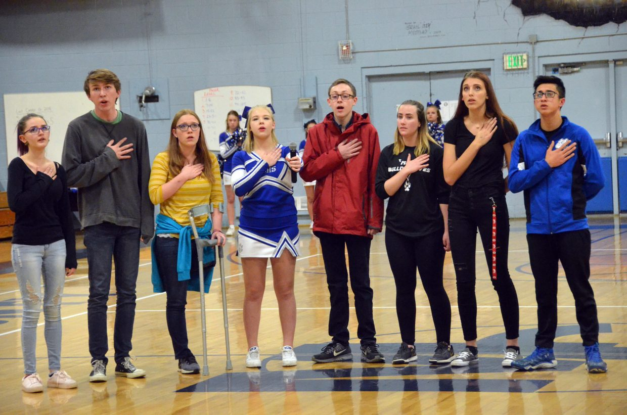 The Moffat County High School Good Vibes A Capella Choir performs the national anthem during Wednesday's games against Steamboat Springs.