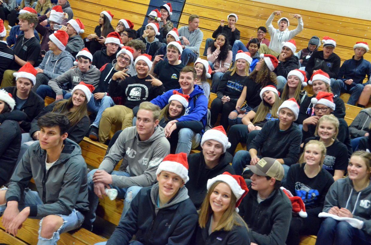 The Moffat County High School student section shows holiday and school spirit during Wednesday's games against Steamboat Springs.
