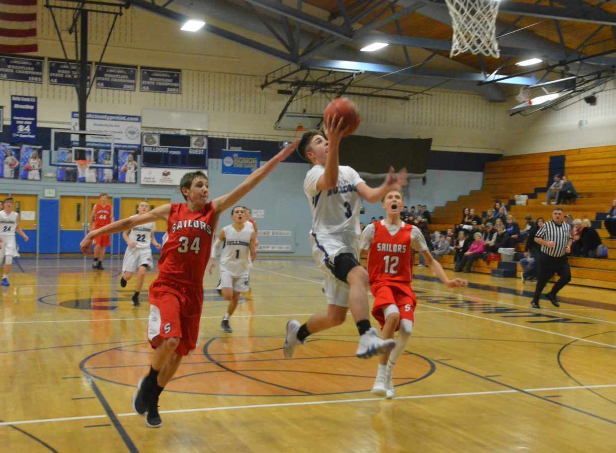 Moffat County High School's Myles Simpson soars in for a bucket during Wednesday's junior varsity game against Steamboat Springs.