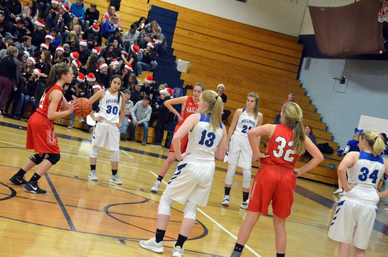 Moffat County High School girls basketball players watch as Steamboat Springs takes a last-second foul shot.