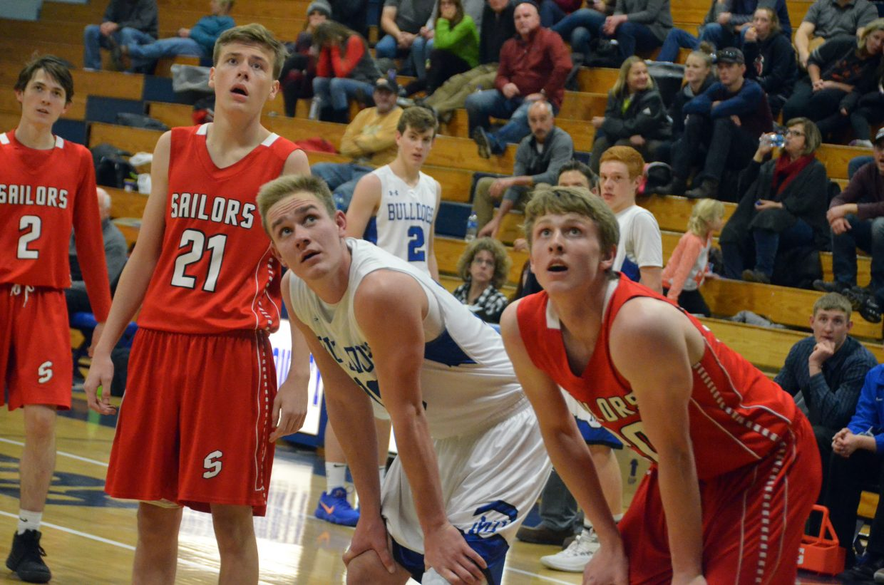 Moffat County High School's Colby Beaver and Sailor opponents watch a Bulldog free throw drop through the net.