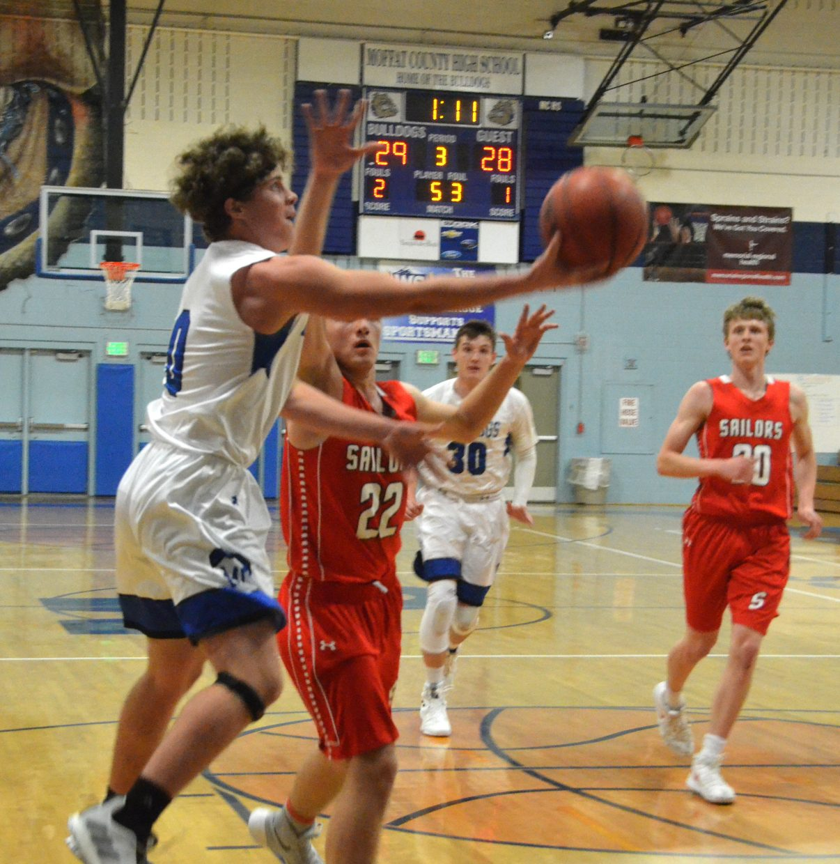 Moffat County High School's Cale Scranton goes in for an underhanded layup against Steamboat Springs.