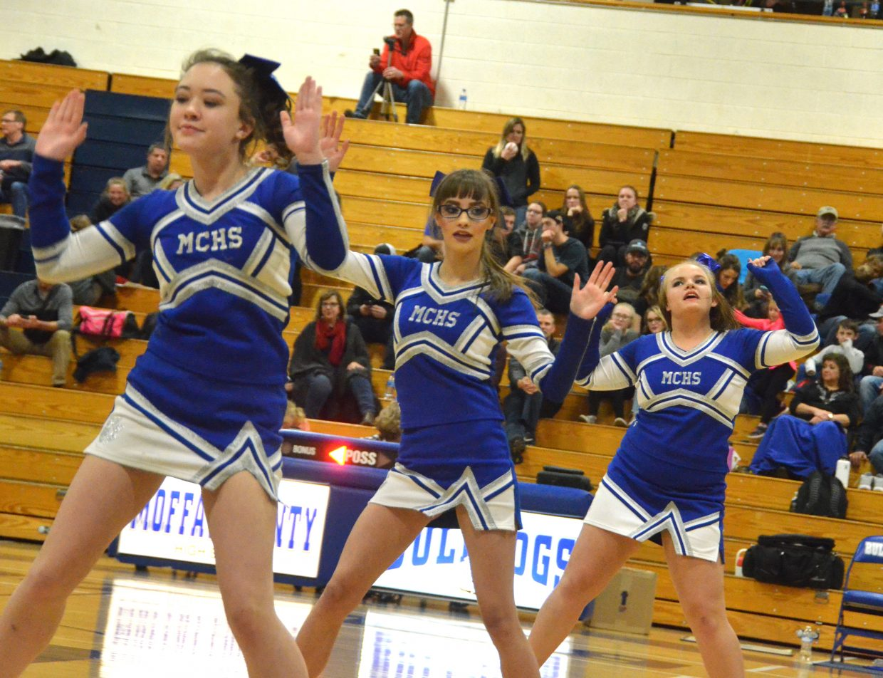 Moffat County High School student cheerleaders perform at halftime of the Bulldog boys basketball game.