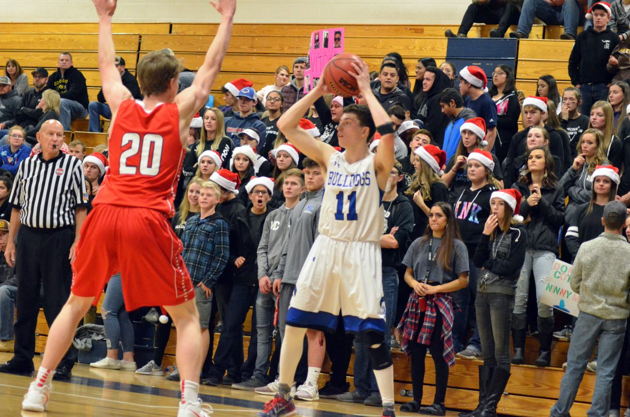 The Moffat County High School student cheers on Connor Murphy as he seeks to get out of a tight spot against Steamboat Springs.