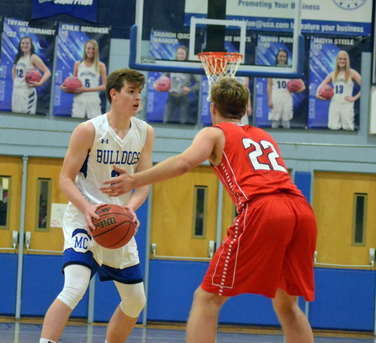 Moffat County High School's Wesley Counts gets a feel for the Sailor defense during Wednesday's game against Steamboat Springs.