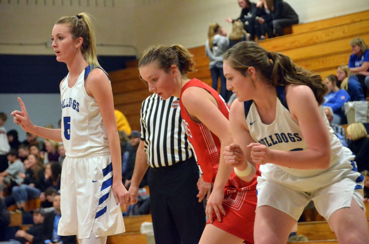 Moffat County High School's Kinlie Brennise, left, and Tiffany Hildebrandt settle in for teammates' free throws against Steamboat Springs.