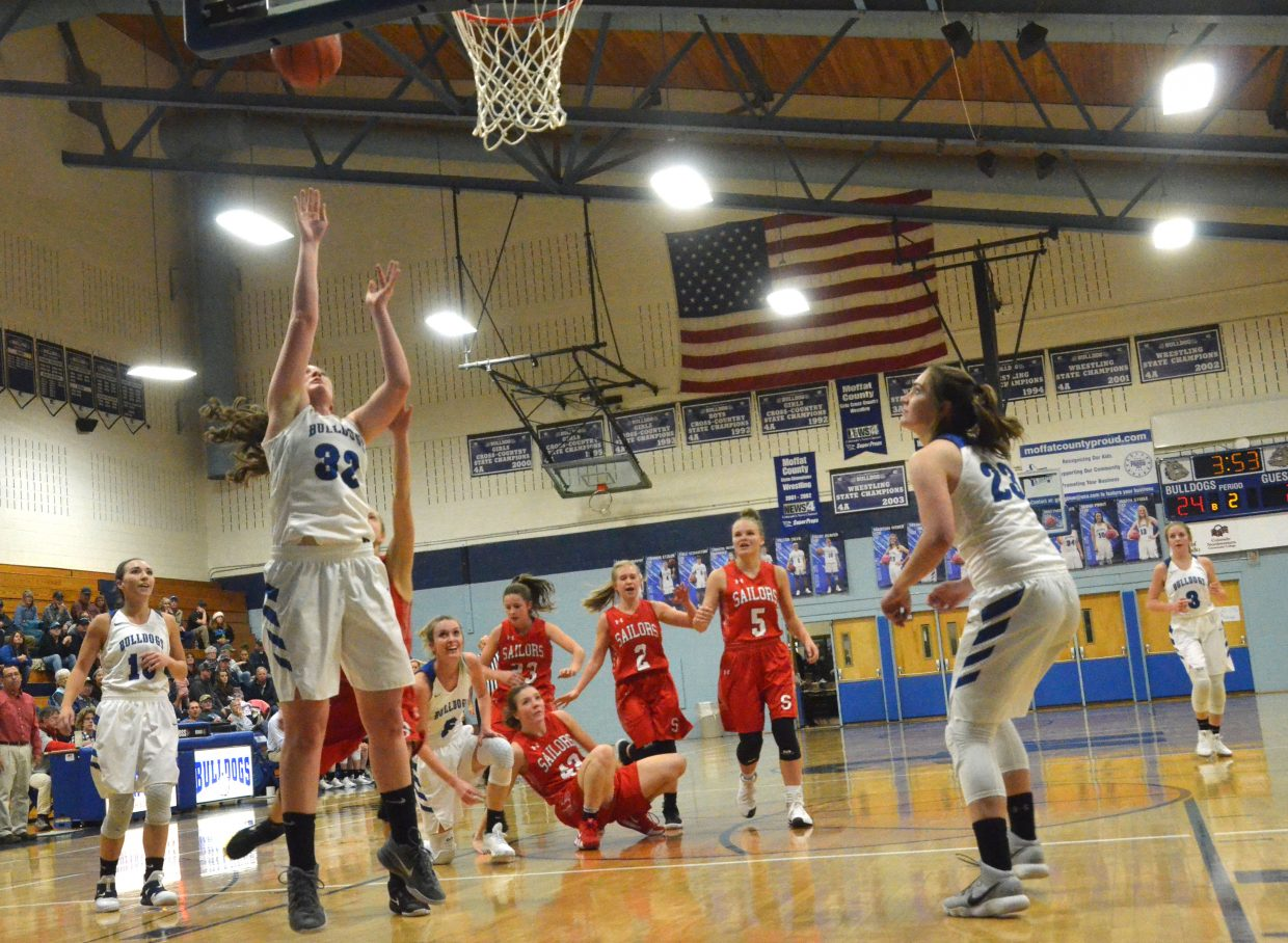 Moffat County High School's Tiffany Hildebrandt banks a backboard shot Dec. 12 against Steamboat Springs.