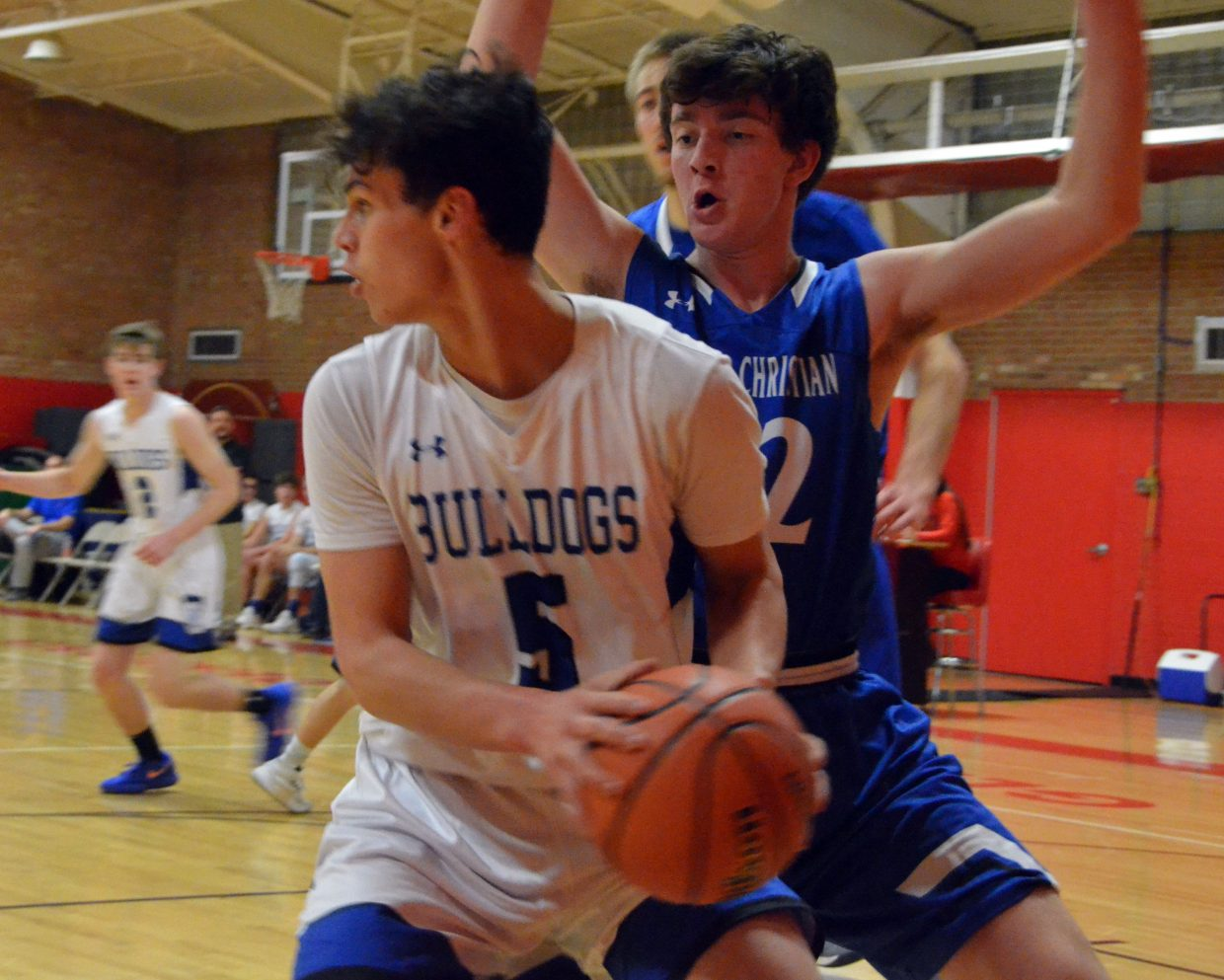 Moffat County High School's Jerod Chacon considers a pass against Denver Christian.
