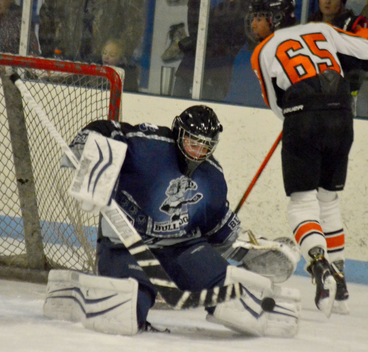 Goalie Jack Doane stops a shot cold during Moffat County Bulldogs' game against Hyland Hills.