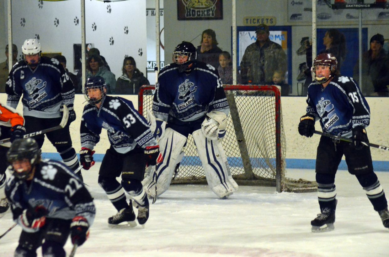 Members of the Moffat County Bulldog hockey team look to turn around and get back on offense during their  game against Hyland Hills.
