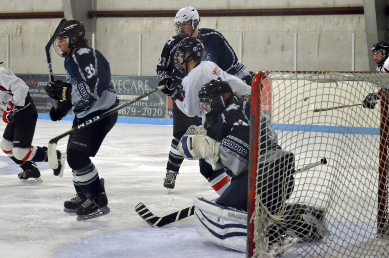 From left, defenders Garrett Anson and Jesse Earle stay on alert along with goalie Jack Doane during Moffat County Bulldogs' game against Cheyenne, Wyoming.