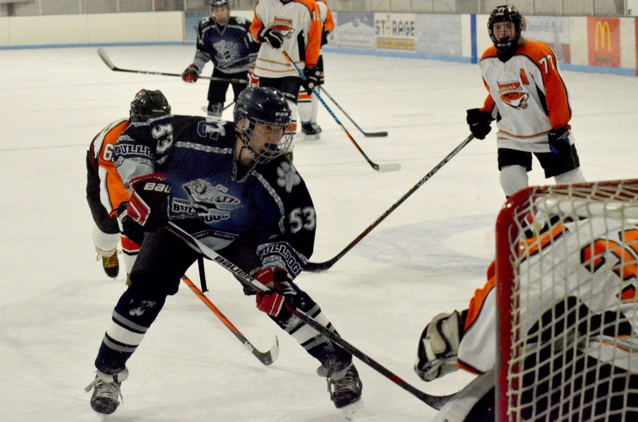 AJ Barber knocks in a goal during Moffat County Bulldogs' game against Hyland Hills.