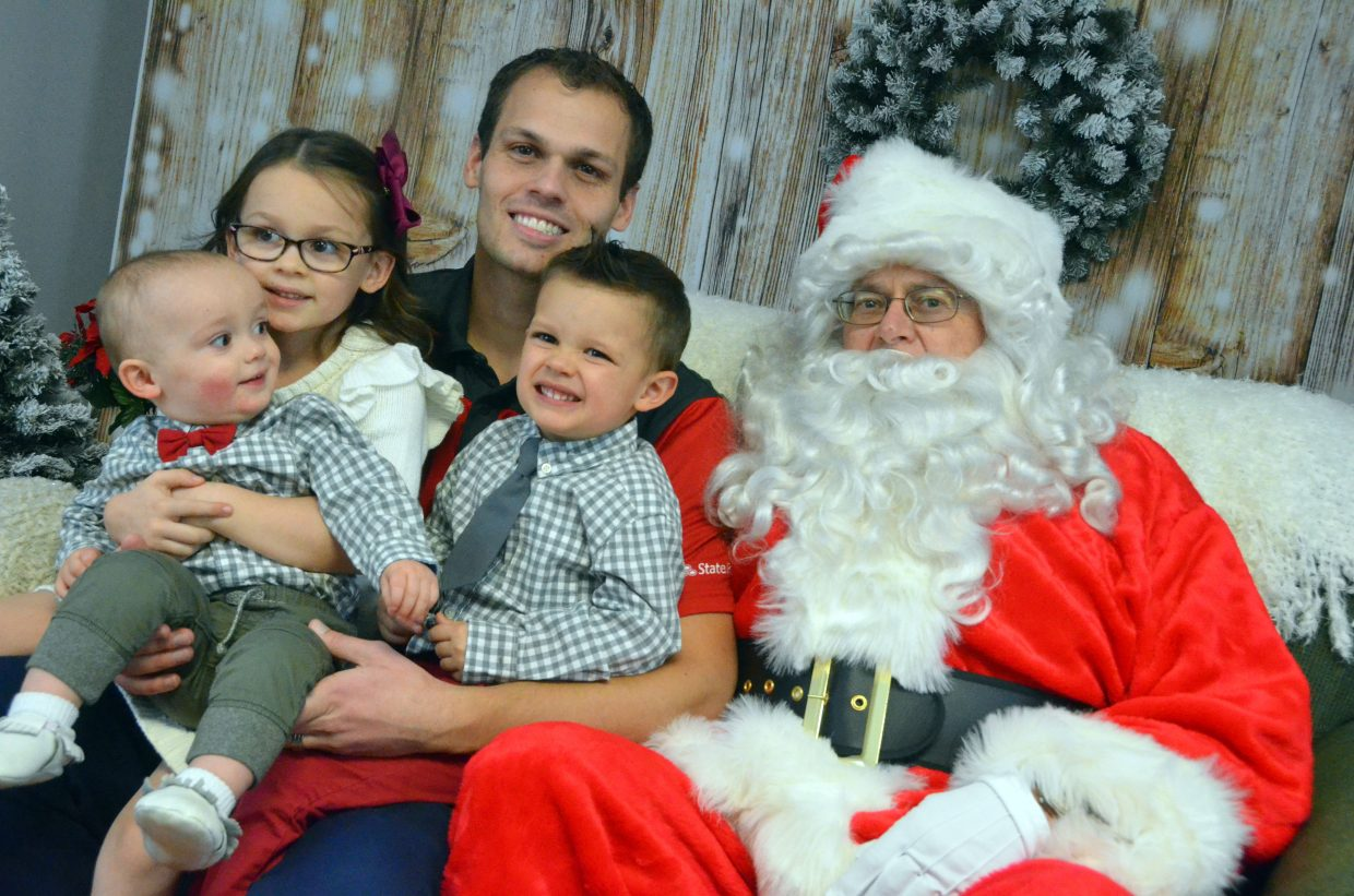 Justin Stokes joins Santa Claus along with his children at Letters to Santa.