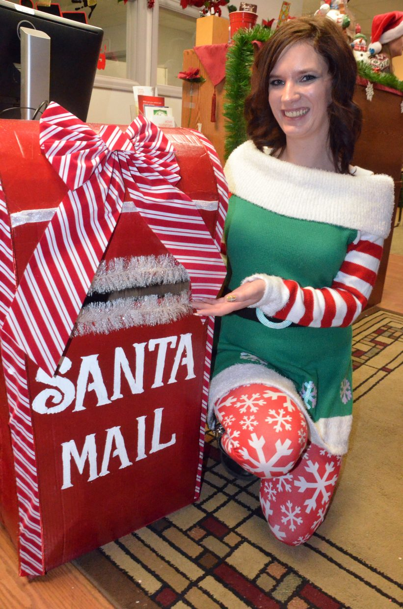 Samantha Verburg with Justin Stokes State Farm Insurance displays the special mailbox for Letters to Santa.