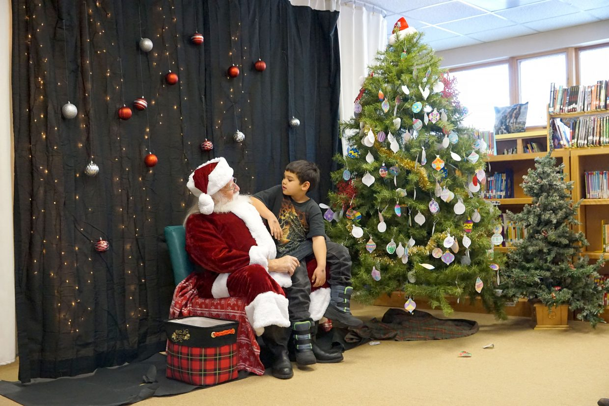 The library at Ridgeview Elementary School was transformed into Santa's workshop on Thursday, Dec. 13, as the jolly old elf listened to wishes and gave out candy canes.