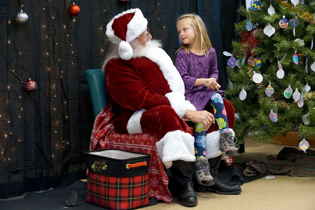 Elise Lienker takes a turn to visit with Santa Claus at Ridgeview Elementary School.