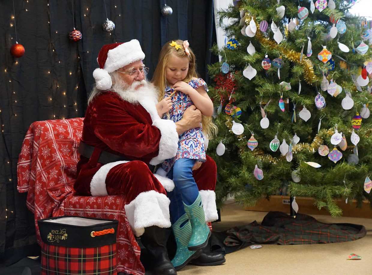 Frankie Counts visits with Santa Claus.