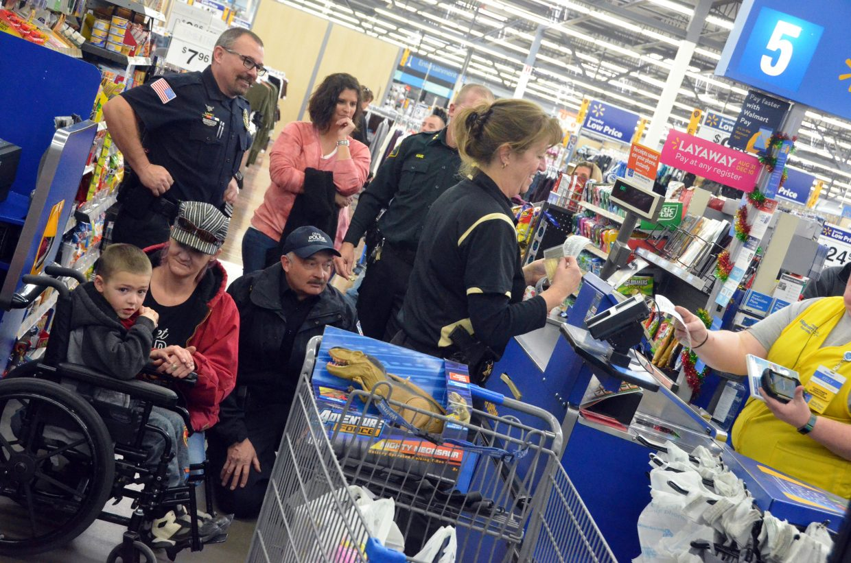 Moffat County Undersheriff Charlene Abdella foots the bill during Saturday morning's Shop with a Cop at Walmart.