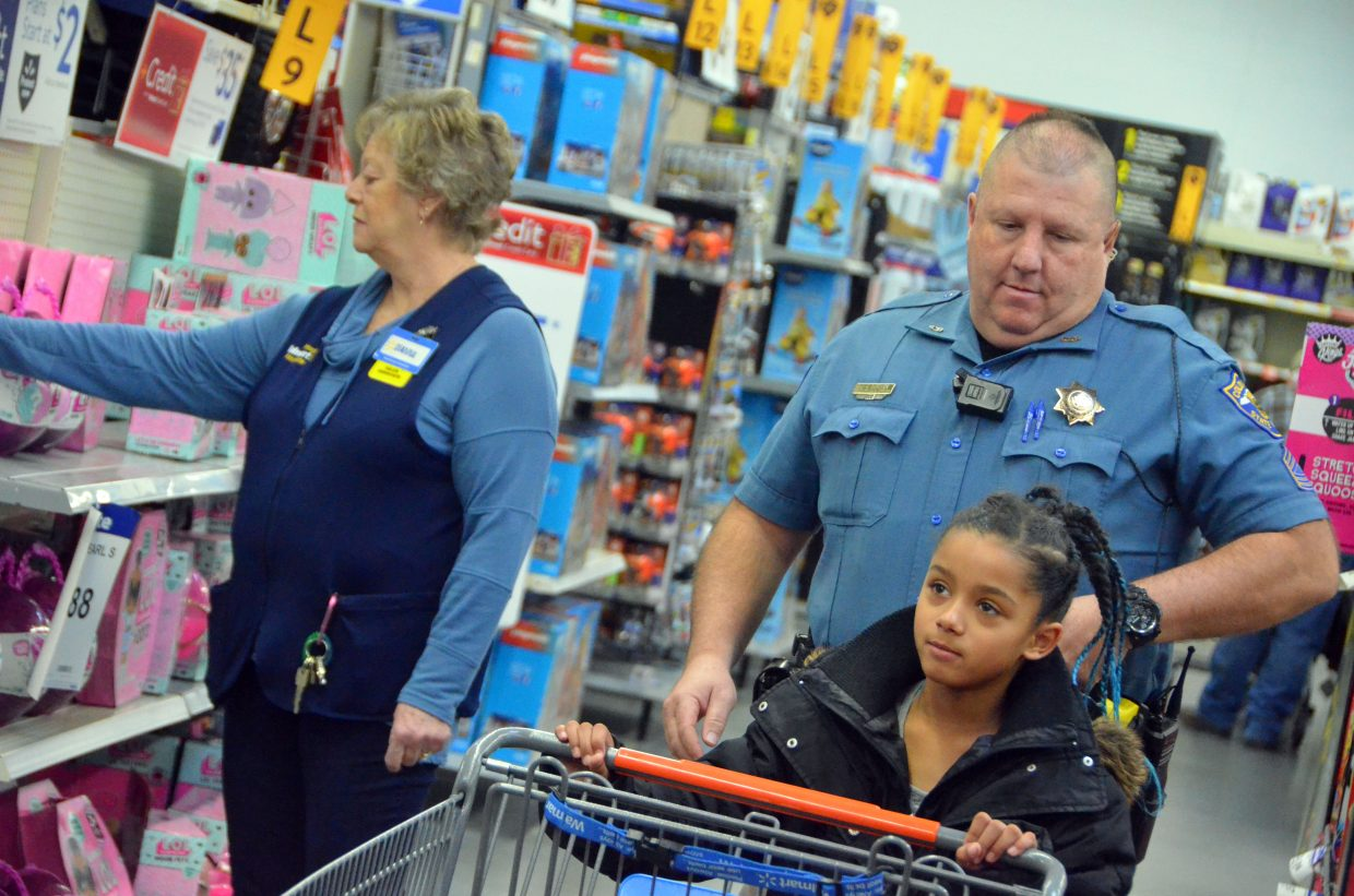 Aaralyn Goebel pushes along her shopping cart during Saturday morning's Shop with a Cop at Walmart.