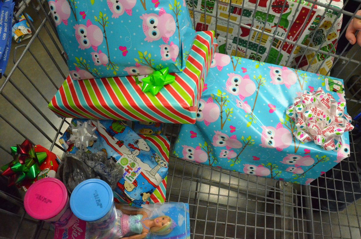 Items purchased during Saturday morning's Shop with a Cop at Walmart are ready to go under the Christmas tree.