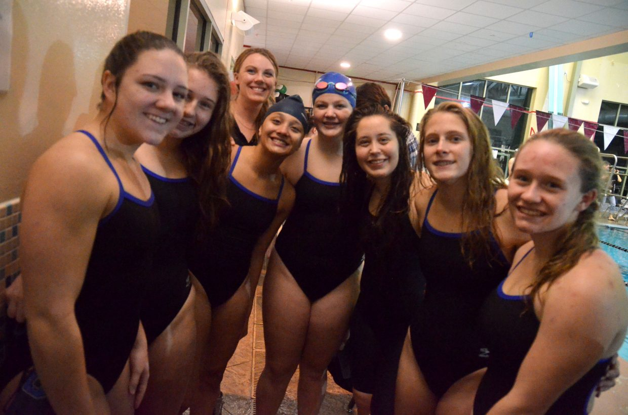 Moffat County High School relay swimmers are a bundle of positive energy after their first state qualification of the season during the 200 freestyle relay at Friday's Glenwood Springs' Demon Meet. From left, Katelynn Turner, Alexa Neton, coach Meghan Francone, Alyssa Chavez, Ellina Jones, Allison Jacobson, Kelsey McDiffett and Molly Neton.