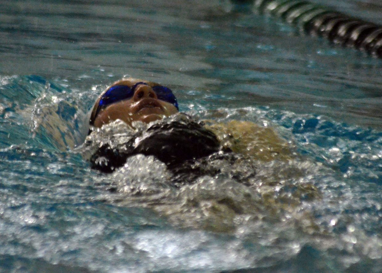 Moffat County High School's Molly Neton kicks off the wall in the backstroke of the 200 individual medley at the Glenwood Springs Demon Meet.