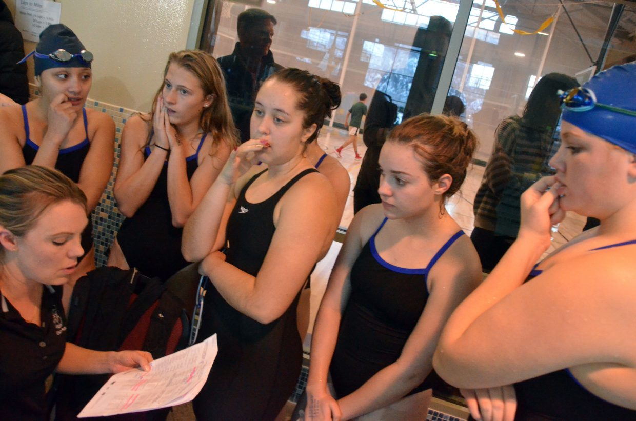 Moffat County High School swim coach Meghan Francone critiques swimmers' work in the medley relay at Friday's Glenwood Springs' Demon Meet.