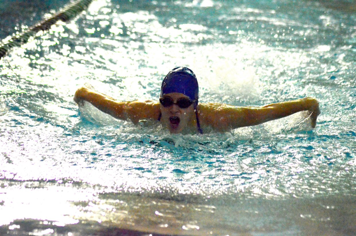 Moffat County High School's Kelsey McDiffett swims the 100 butterfly at Friday's Glenwood Springs' Demon Meet.